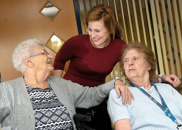 Emily with residents Dorothy Burton and Flo Quick.