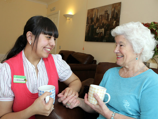 Chrissie, the Well-being Advisor at ExtraCare's Lark Hill Village, with a resident